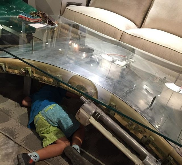 Reusing Airplane Parts In Furniture Amazing Design Here Is A Coffee Table Made With An Airplane Door Durable For The Kid To Repair Functions For Use And Fashionable For The Adult 24estyle